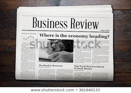 a newspaper on a wooden desk   economic news stock photo © zerbor