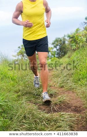 Méconnaissable homme courir boue sale vêtements Photo stock © asturianu