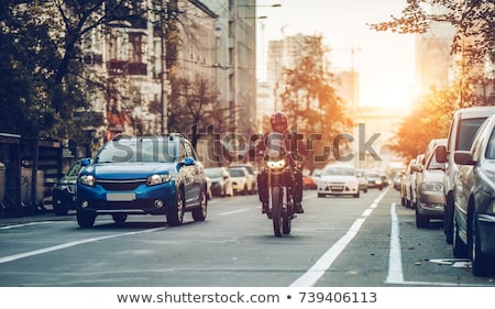 Motorcyclist on the city background Stock photo © bezikus