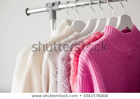 hanger rack with warm women clothes winter collection stock photo © vectorikart
