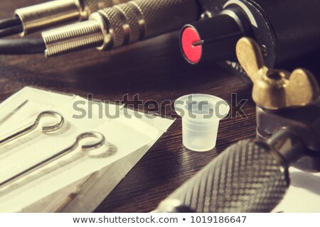 tattoo machines and equipment on wooden background stock photo © natali_brill