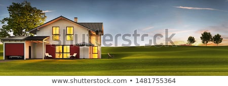 beautiful view on modern beautiful houses and field stock photo © massonforstock
