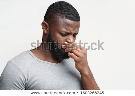 Man with nose bleed Stock photo © Chalabala
