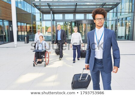 Businessman handicapped in wheelchair. Manager with suitcase Stock photo © MaryValery
