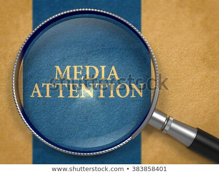 Media Attention through Lens on Old Paper. Stock photo © tashatuvango