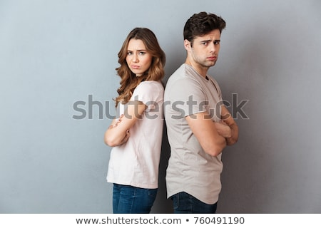 Offended loving couple standing isolated Stock photo © deandrobot