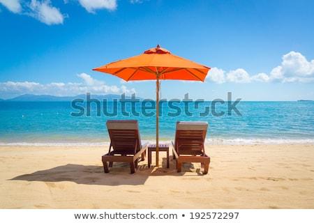 Stock photo: Ocean scenes with umbrellas on beach