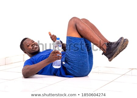 portrait of a young smiling african sports man showing thumbs u stock photo © deandrobot
