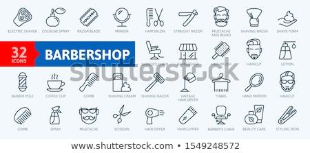 Man shaving with straight razor Stock photo © LightFieldStudios