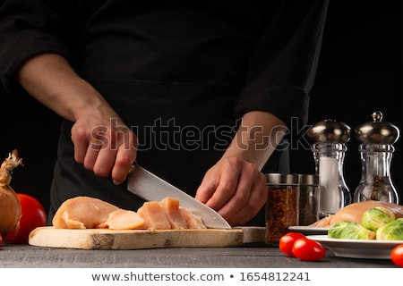 Chief cook holding roasted chicken. Stock photo © RAStudio