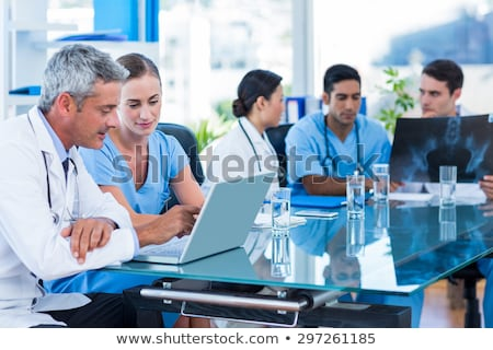 Female doctor, smiling, x-rays behind Stock photo © IS2