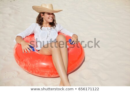 Pretty woman sitting in buoyancy ring Stock photo © IS2