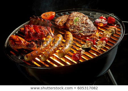 charcoal barbecue grill with grilled sausages stock photo © studioworkstock