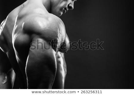 jóképű · férfi · fekete · mutat · abdominális · izmok · férfi - stock fotó © ra2studio