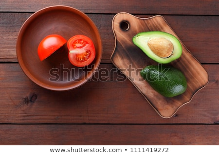 Ripe cherries in a clay bowl on wooden background Stock photo © vlad_star