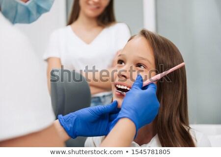 oral · cavidade · imagem · mulher · jovem - foto stock © nessokv