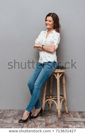 Csinos barna hajú pózol szék kandalló szexi Stock fotó © acidgrey