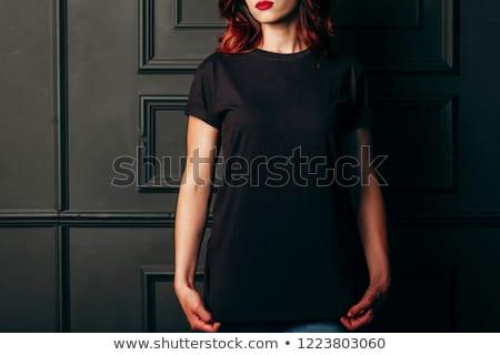 Fiatal barna hajú visel fekete póló farmernadrág Stock fotó © acidgrey