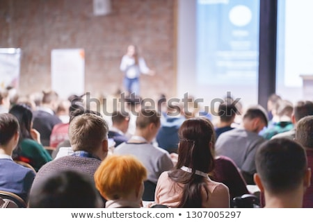 adult students group listen to professors lecture and asking qu stock photo © snowing