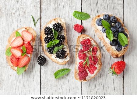 Foto stock: Brushetta Or Traditional Spanish Tapas With Various Berries