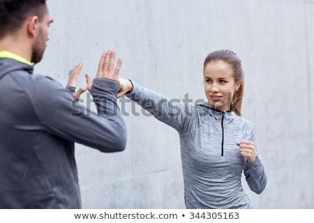Feliz mulher treinador trabalhando greve ao ar livre Foto stock © dolgachov