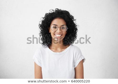 Portré mosolygó nő sötét göndör haj visel vörös ruha Stock fotó © deandrobot