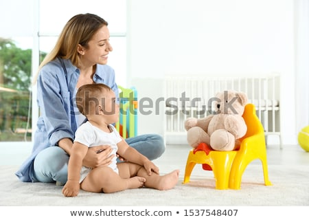 Female Toddler Sitting On A Potty Pot Stock photo © AndreyPopov