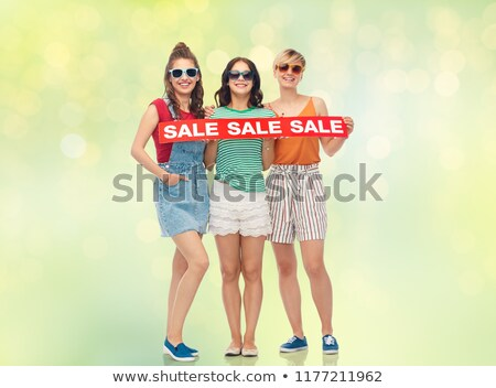 teenage girls with sale banner over festive lights Stock photo © dolgachov
