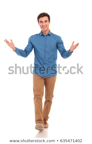 Excited young  man stepping and looking forward Stock photo © feedough