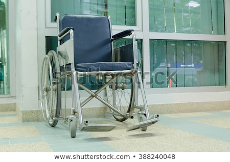 Empty Wheel Chair In Hospital Corridor Stock photo © AndreyPopov
