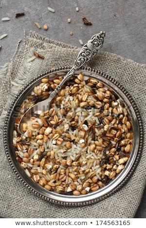 Uncooked multigrain rice in metal plate on wooden background Stock photo © Melnyk