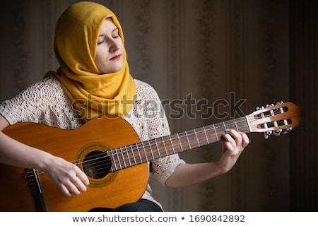 Emiraty hidżab muzyki zestaw dziewczyna Zdjęcia stock © toyotoyo