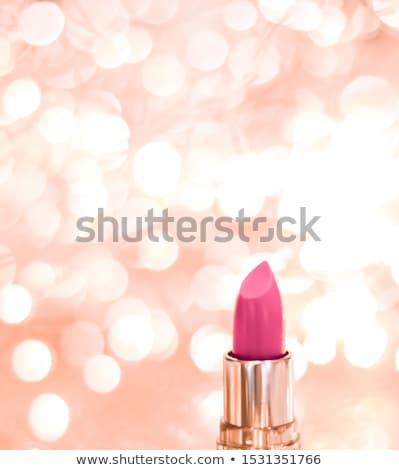 Pink lipstick on rose gold Christmas, New Years and Valentines D Stock photo © Anneleven