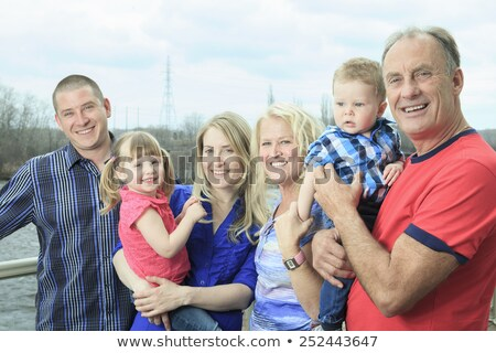 an outside family portrait with gran father and mother stock photo © lopolo