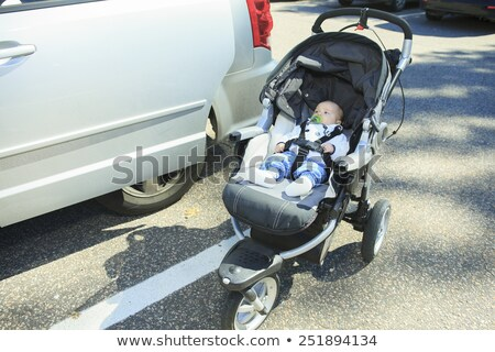Lonely baby in a stroller on the parking Stock photo © Lopolo