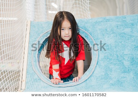 Cute little girl of Asian ethnicity in costume of super girl looking at you Stock photo © pressmaster