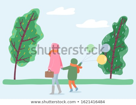 Mother and Kid Strolling in Park, Windy Weather Stock photo © robuart