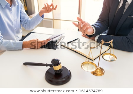 Legal counsel presents to the client negotiating a contract Seri Stock photo © snowing