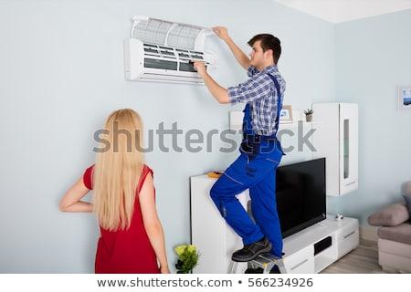 Mulher olhando técnico ar condicionado mulher jovem Foto stock © AndreyPopov