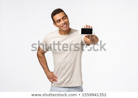 Impressed, satisfied good-looking hispanic guy in good shape, promote fitness application, looking m Stock photo © benzoix