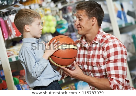 Father with son and ball in shop stock photo © Paha_L