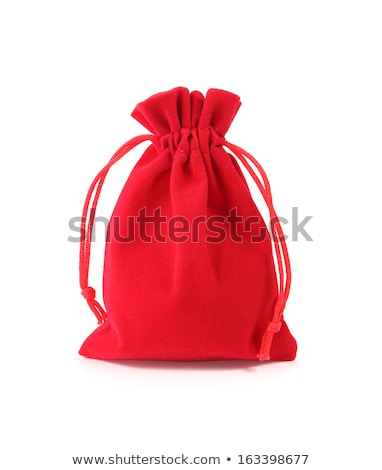 Red velvet pouch with coins isolated on white background Stock photo © pinkblue