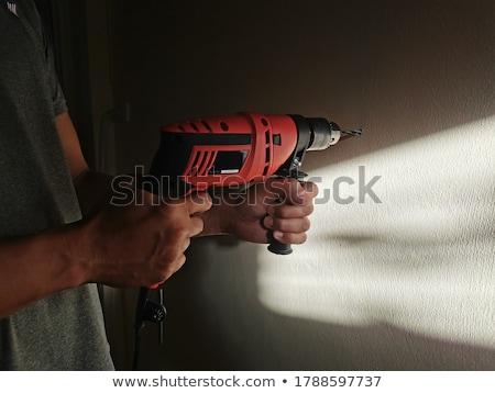 man drilling through wall stock photo © photography33