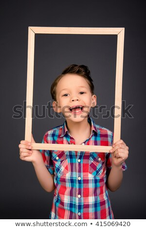 Funny child holding frame Stock photo © Yaruta