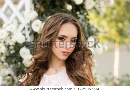 beautiful woman in long evening dress with bunch of flowers. Stock photo © Pilgrimego