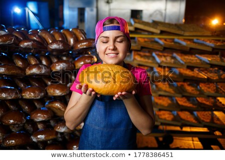 Baker posing with her bread Stock photo © photography33