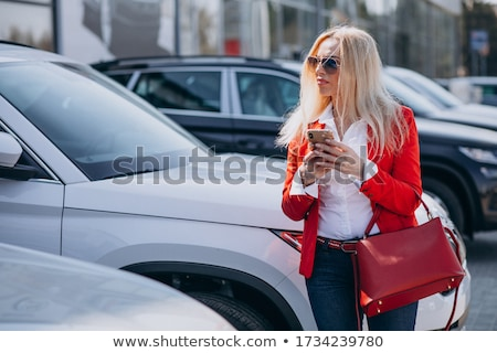 Blond woman with red bag Stock photo © photography33