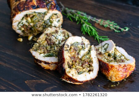 Stok fotoğraf: Baked Pork Tenderloin Filled With Spinach And Goat Cheese On Cre