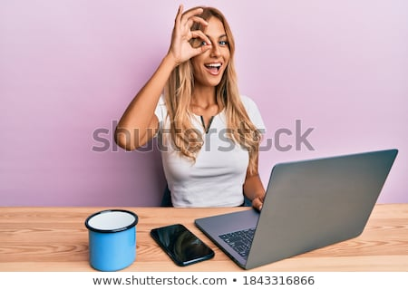Young blonde with a computer symbol Stock photo © photography33