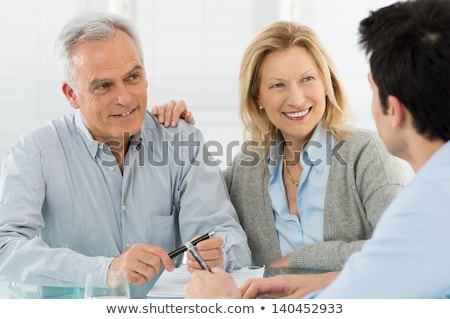 mature business couple discussing a document stock photo © photography33